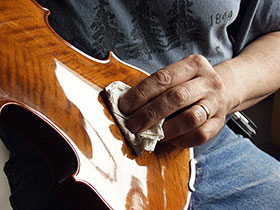 Polishing a Violin