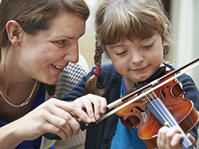 Teacher and violin student